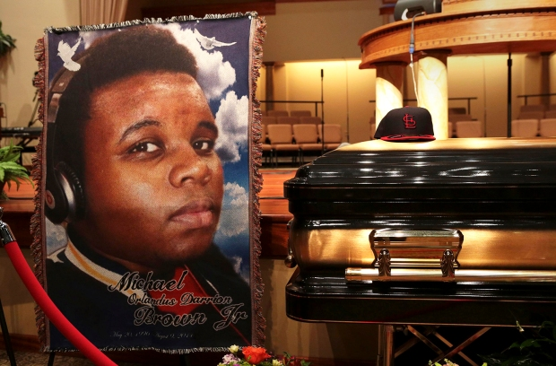 A baseball cap and a portrait of Michael Brown is shown alongside his casket inside Friendly Temple Missionary Baptist Church before the start of funeral services in St. Louis