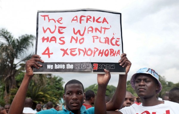 Foreign National holding placards in protest against xenophobia in South Africa